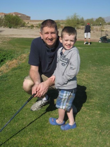 Son and father playing golf