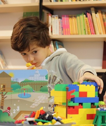 Preschool boy playing with legos
