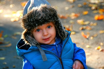 Bundled up little boy in the fall