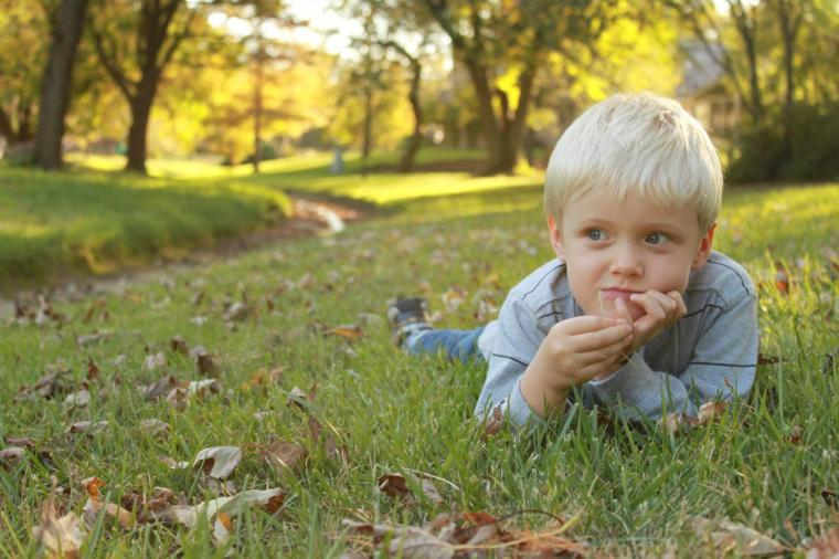 Child in nature on grass