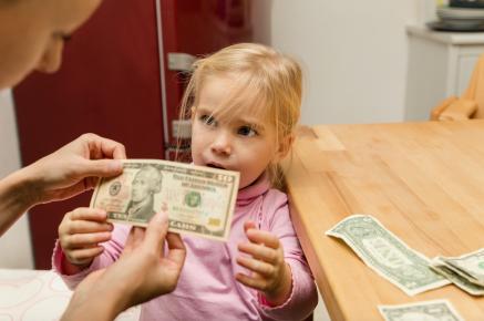 Little girl receiving an allowance