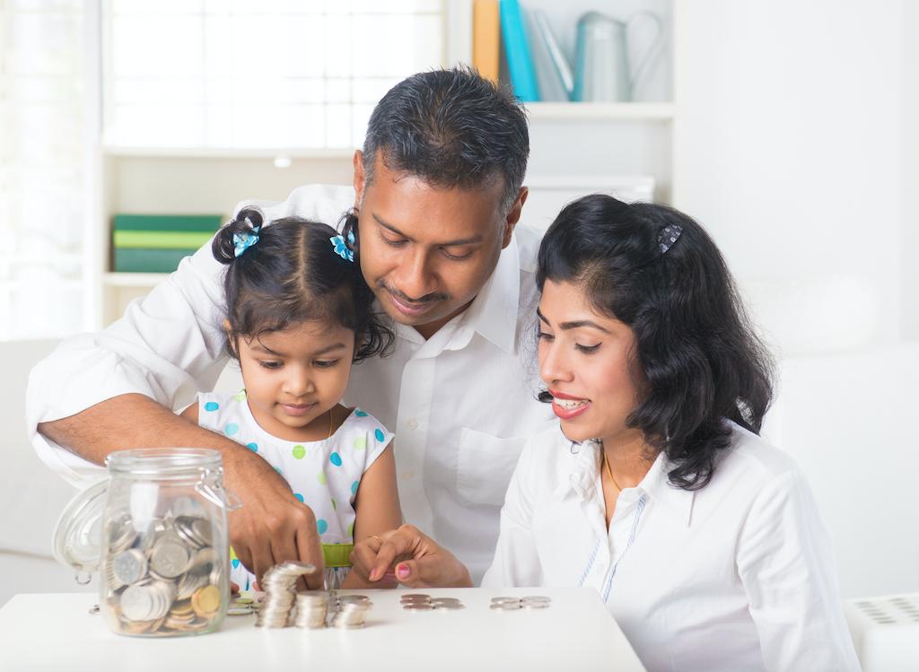 Family teaching little girl about money