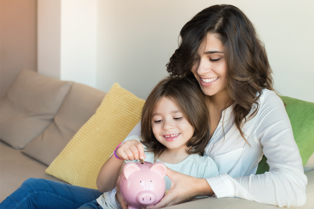 Young mother teaching her daughter about money management